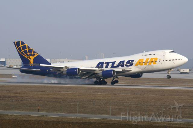 Boeing 747-400 (GTI8904) - Atlas airliner, 747-400. Beautiful plane. Caught right on  left wheel strike. (crosswinds)