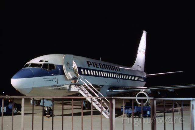 """Boeing 737-700 (N779N) - Another night shot of Piedmont Airlines 737, named """"Rappahannock Pacemaker"""".   From a 35mm slide shot in early 1980's."""