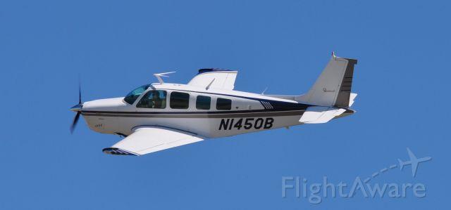 Beechcraft Bonanza (36) (N1450B) - Photo taken by Duane Deniston at KTKX.  I was leaving KTKX for KBNA.