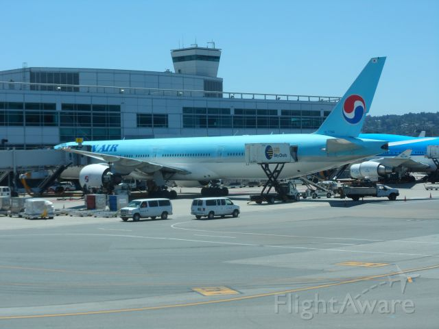 Boeing 777-200 (HL7784) - Korean Air parked at gate after flight from ICN.