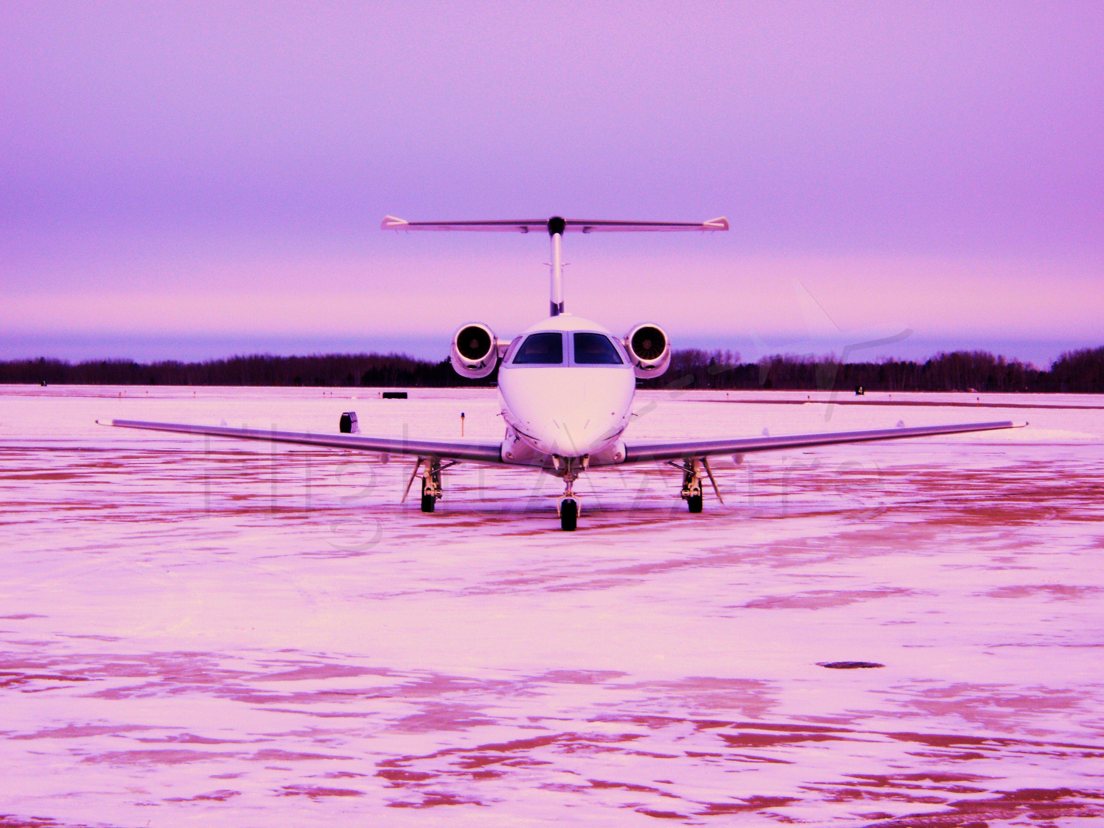 Embraer Phenom 100 (N876JC) - Taken in Bemidji,MN in late December. -22 degrees C.
