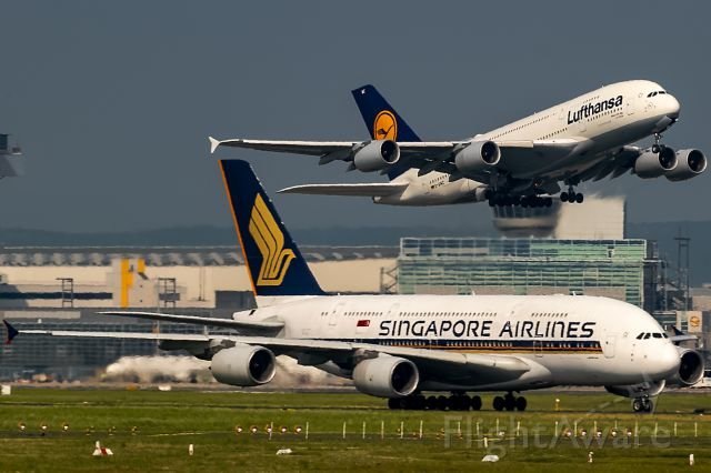 Airbus A380-800 (D-AIMC) - the flying is the sharp one, the other is heazy!