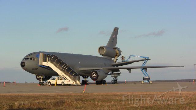 — — - Crews perform maintenance work on a McDonnell Douglas KC-10 Extender at Gander International Airport.