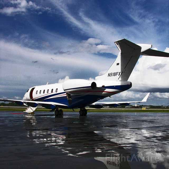 Bombardier Challenger 300 (N518FX) - Parked at Dolphin Aviation on October 7, 2007, after a rain shower.