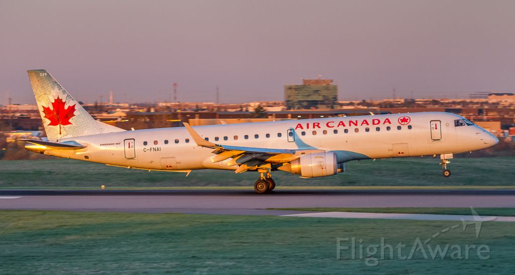 Embraer ERJ-190 (C-FNAI) - Sun just peeking over the Eastern horizon lighting up this Air Canada Embraer on runway 33L