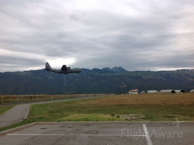 Lockheed C-130 Hercules — - C-130J on short final in Northern Italy; prepping to drop some Sky Soldiers from the 173rd Airborne Infantry Brigade.