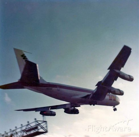Boeing 720 (UNKNOWN) - I've been an aircraft spotter/photographer since I was twelve years old. Here's one of my early images taken way back in 1973. Camera, Kodak X-15 instamatic.
