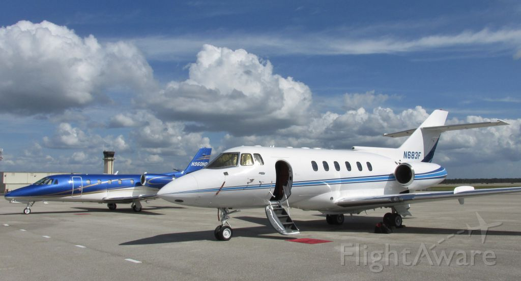 Raytheon Hawker 800 — -  Hawker 800A on the ramp at Fort Meyers Southwest Regional, next to this nice looking Citation Excel