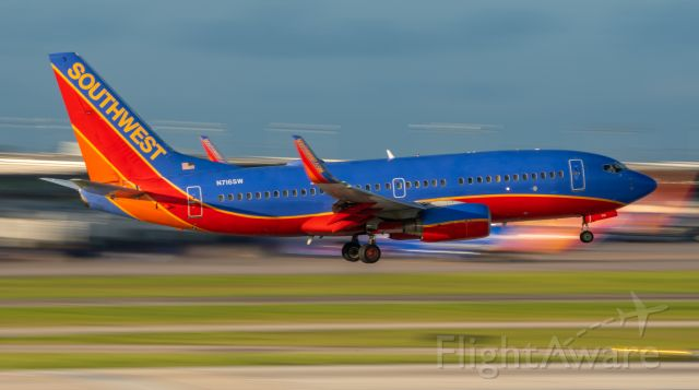 Boeing 737-700 (N716SW) - Trying a 1/15 shutter as B737-7 N716SW lands at HOU on 23 June 2021