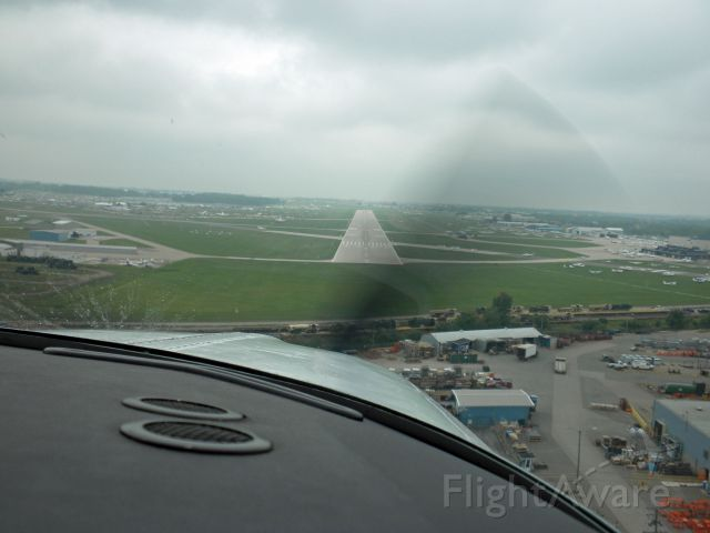 Beechcraft Bonanza (33) (N1854X) - Arriving runway 27 OSH on Saturday 7/31/10