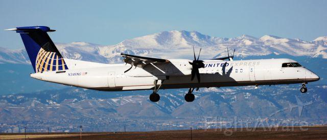 de Havilland Dash 8-400 (N346NG) - Landing on 34R, Mount Evans in the background.