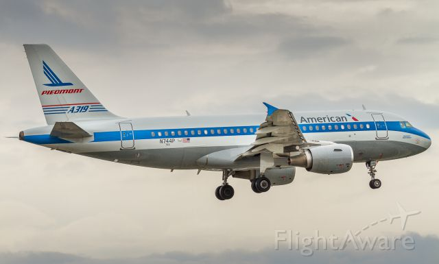 Airbus A319 (N744P) - Piedmont retro on short finals for runway 23 at YYZ on a grey day for plane spotting