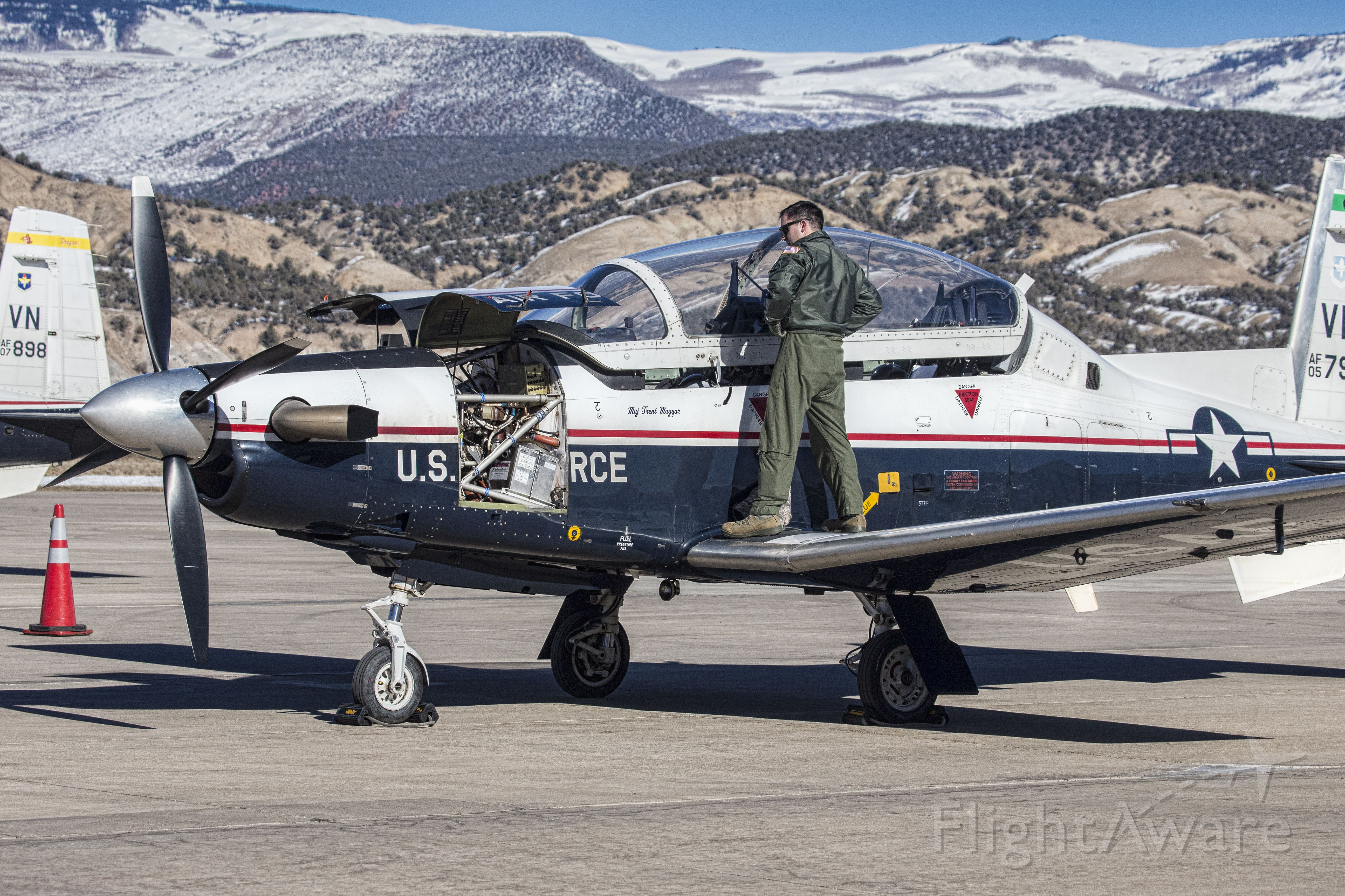 — — - T-6C Texan II Turboprop Military Trainer (Hawker Beechcraft) for Air Force, Marine Corps, Navy and Coastguard. Photo taken at Eagle County Regional Airport, KEGE