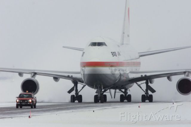 Boeing 747-200 — - A Japanese government Boeing 747-400 following a pilot car at Calgary International Airport.
