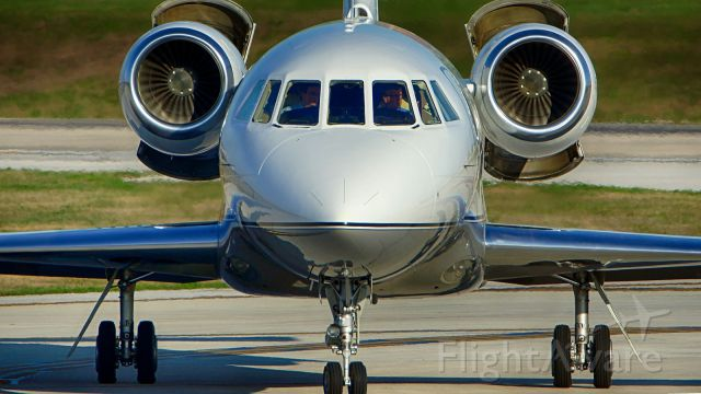 Dassault Falcon 2000 (N923JE) - Exiting 4 after arrival.