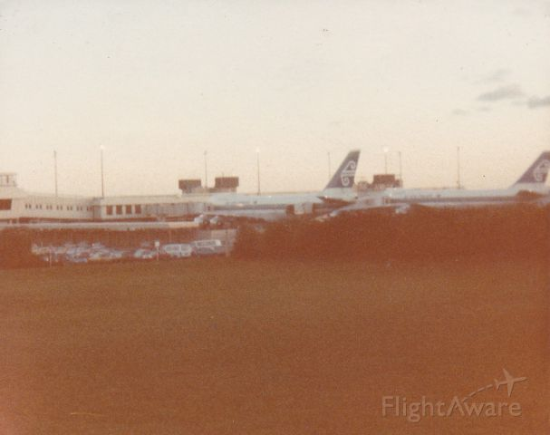 Boeing 747-200 (ZK-NZZ) - another rare photo to my collection these two brand new 747-219 delivered to Air NZ back in 1982 ZK-NZZ ZK-NZX replaced the out going DC10-30 aircraft in the fleet looking at them nosed up at gate3 & 5 as TE 5 & TE22 before the airline changed there codes to NZ taken from 100 meters zoom lens camera 1982