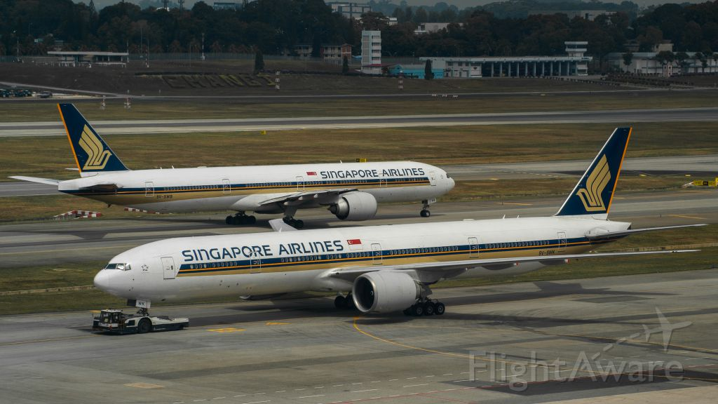 BOEING 777-300ER (9V-SWK) - Sister Aircraft passing each other