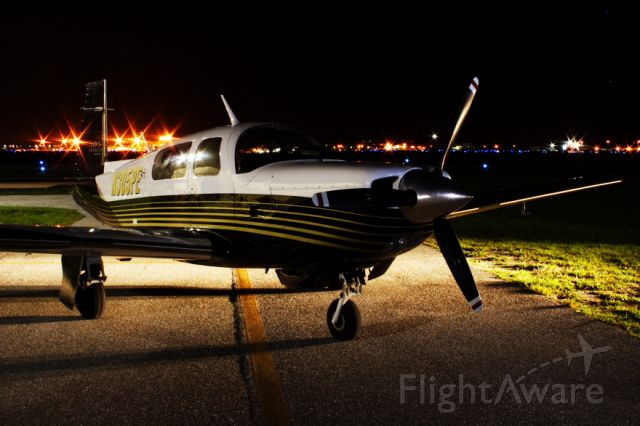 Mooney M-20 Turbo (N305PE) - Miss Long Legs and Brains at night