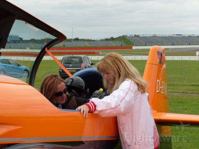 D-EPXA — - EGBV is Silverstone, England. Type is XtremeAir Sbach 300. Photo taken on 18AUG2009. c/n 007. Privately owned. Kathel Boulanger of the French team and Svetlana Kapanina of the Russian team inspect the controls of the Xtreme Air Sbach 300 of the German team prior to commencement of the World Aerobatic Championships (WAC) 2009. Svetlana is in the cockpit.
