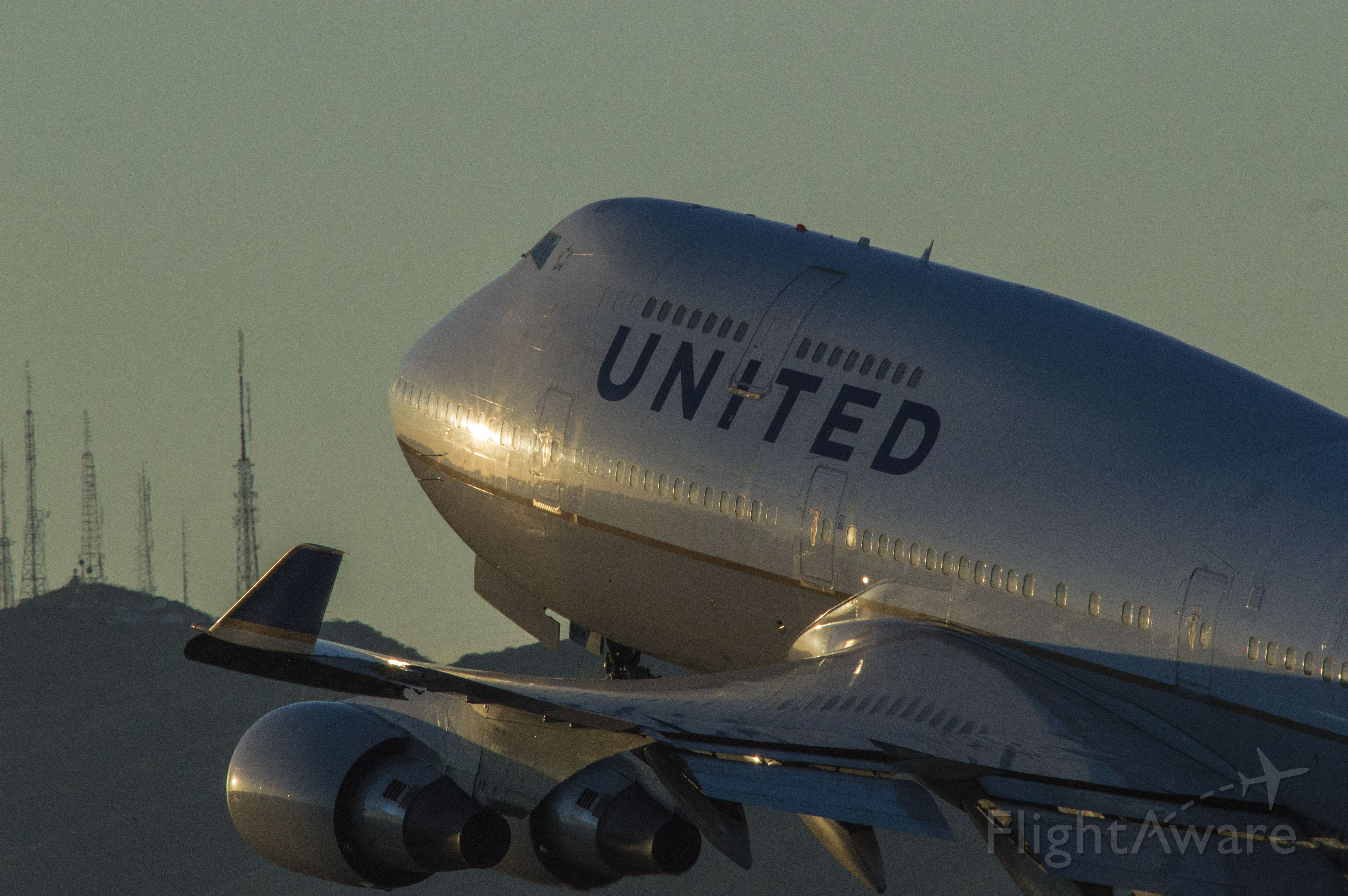 — — - United 747 lifting off to a far away destination at KSFO