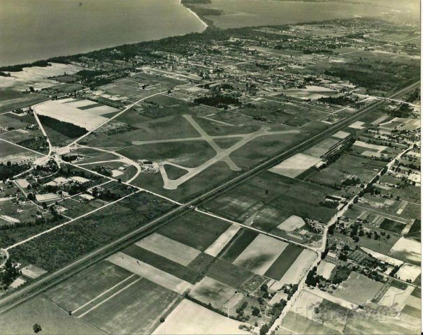 — — - A very old photo of Erie Airport in Erie Pa. Yes it is paved now......