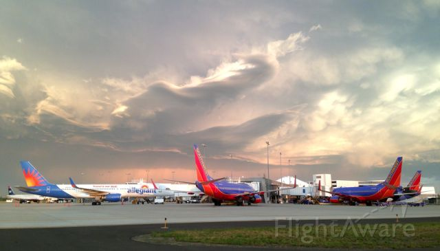 Boeing 757-200 (N901NV) - Morning rush hour here at the airport. The three Southwest Boeing 737-700s prepare for their flights to Denver, Oakland, and Chicago respectively, while the Allegiant Air Boeing 757 prepares for its long flight to Honolulu. In the background under the 757