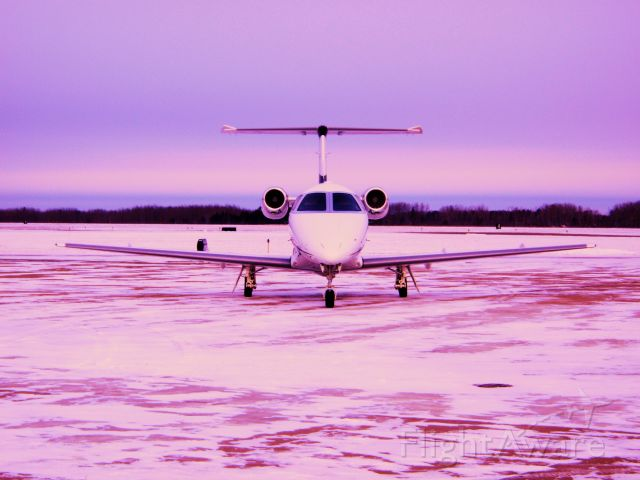 Embraer Phenom 100 (N876JC) - Taken in Bemidji,MN in late December. -22 degrees C.