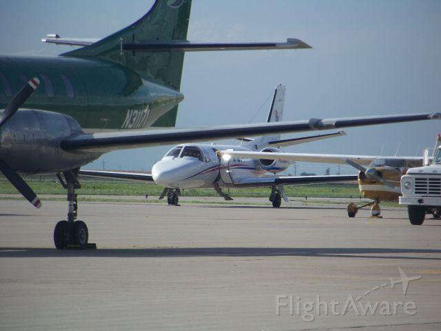 — — - Kansas University Jet at Garden City, Kansas Airport