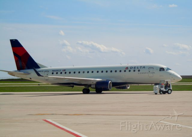 Embraer 170/175 (N605CZ) - Parked after diverting from KCLT due to storms over Minneapolis. Photo taken on 5/29/2011