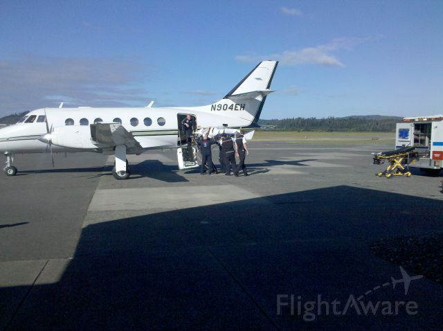 British Aerospace Jetstream 31 (N904EH) - Loading a patient into an Air Ambulance Plane.