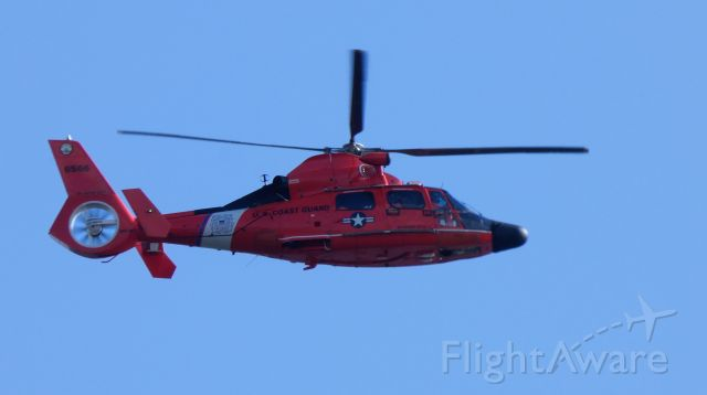 """Aerospatiale Dauphin 2 (SA-365C) (N6566) - Making a low pass is this US Coast Guard Aerospatiale MH-65C Dolphin rotorcraft in the Winter of 2020. Of course there is no """"N"""" in this military helo's registration number."""