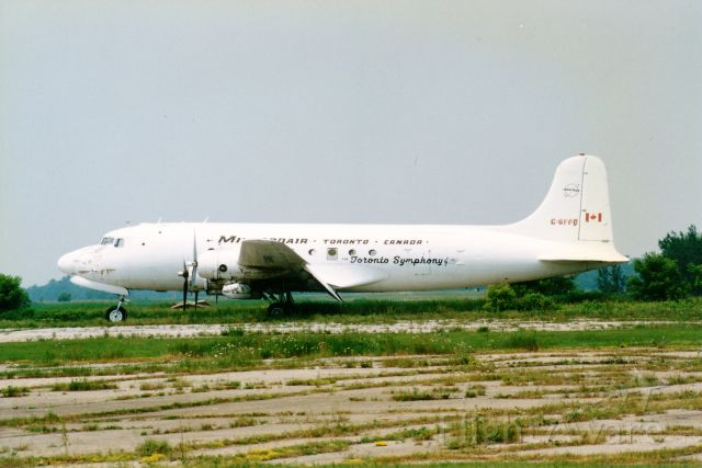 Douglas DC-6 (C-GFFD) - This is probably one of the rariest photos i have in my collection,this old beauty sitting out in the field at Brantford Airport,Brantford,Ontario,Canada,Taken back in the 1990