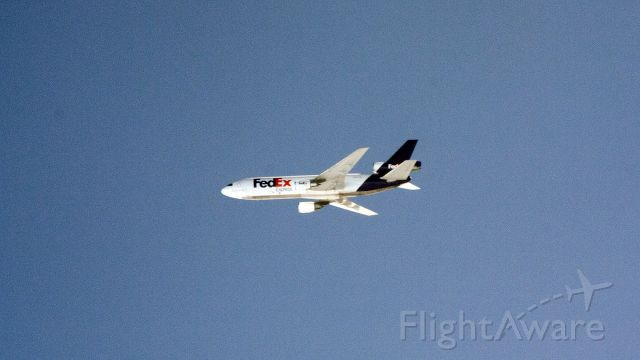 McDonnell Douglas DC-10 — - Passing by this wide body cargo airplane at 40,000 feet.