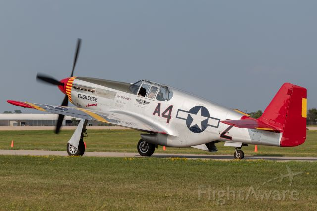 North American P-51 Mustang (N61429) - A P-51C taxis after flying with other P-51s at EAA Airventure 2019.