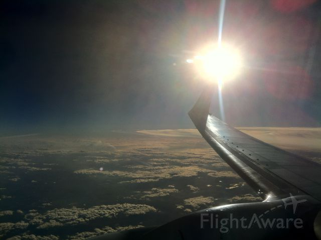 Boeing 737-700 — - From AMS to BUD. Cloud formations with sun