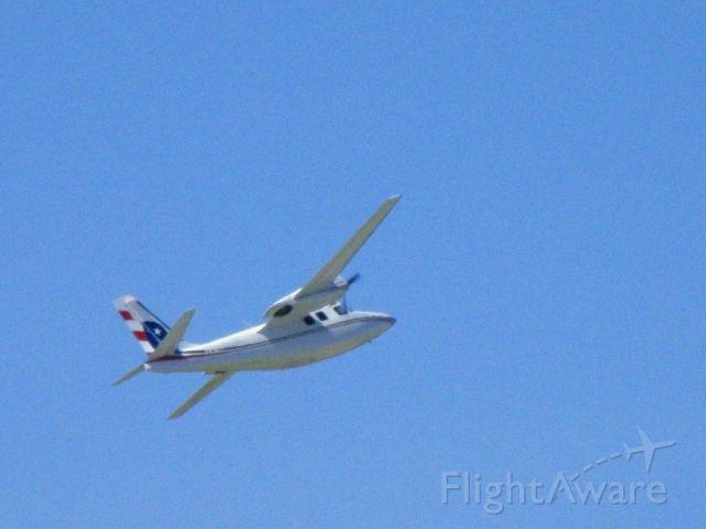 Aero Commander 500 (N214JA) - N214JA, an Aero Commander, turns north for their destination....