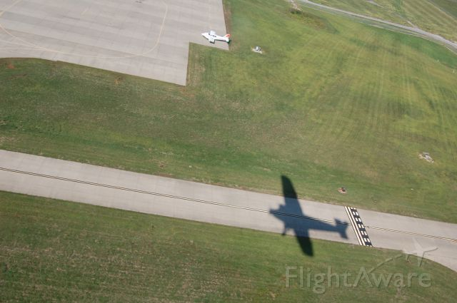 Ford Tri-Motor (NAC8407) - Shadow of the EAA Ford Tri-Motor in flight over Lees Summit, MO airport on 9-11-11.