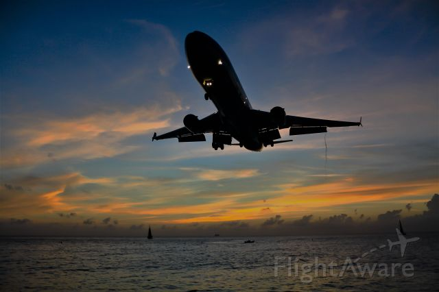 Boeing MD-11 (PH-KCD) - A great sight to see at the end of a wonderful day. KLM MD11 PH-KCD gracefully approaching the beach for landing!