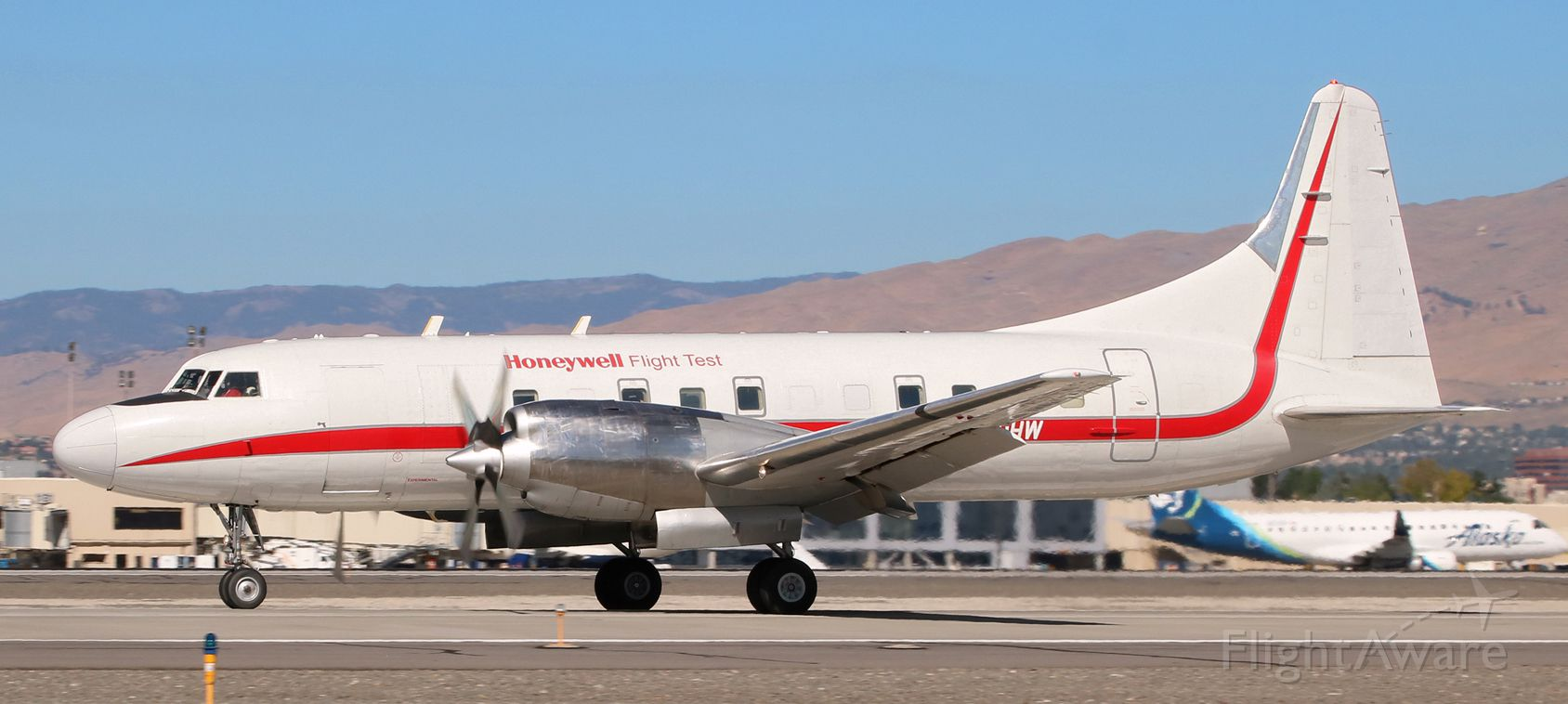 CONVAIR CV-580 (N580HW) - Could not help having a flashback to a wonderful era of aviation as I snapped this 1952 Convair 340 / 580 (N580HW) as it went past me on its deceleration roll after landing on RNO