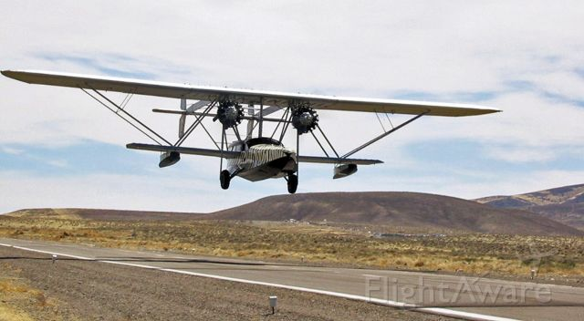 """Sikorsky S-38 Replica (N28V) - N28V, a replica of """"Osa's Ark,"""" a black and white Tiger striped 1929 Sikorsky S-38B Flying Yacht, is just off Tiger Field's runway 33 (in Fernley, NV) and back in the air to complete the last 35 miles of an Elko-to-Reno trip (KEKO-KRNO) in this photo taken 14 years ago in 2006."""