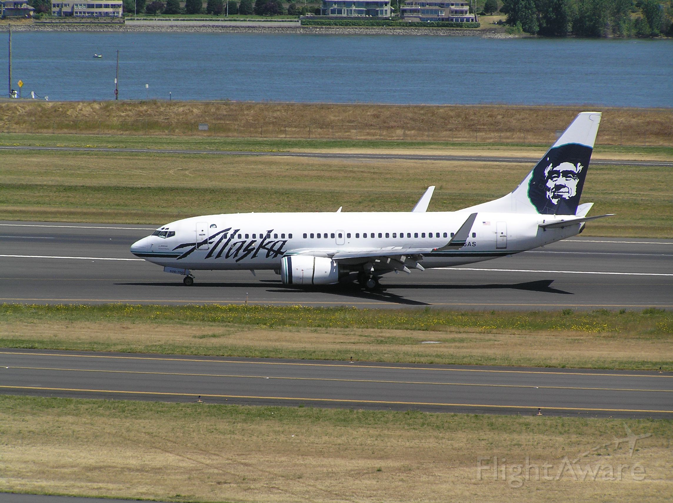 Boeing 737-700 (N626AS) - July 6, 2011, near midday. Departing 28R, inbound for gate.