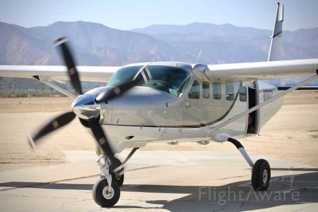 Cessna Caravan (N208ZZ) - Caravan picking up a new load of skydivers. The sound of this engine and prop gives me chills