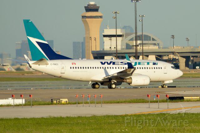 Boeing 737-700 (C-FWCC) - Departing DFW 05/22/2013