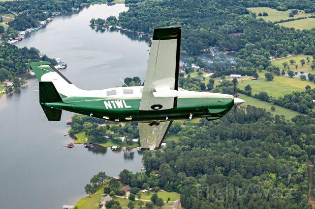 Piper Malibu Mirage (N1WL) - MMOPA 2-Page Spread Photo