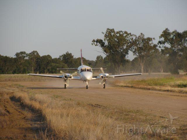 Piper Navajo (VH-FUI) - VH-FUI Taxing for fuel.