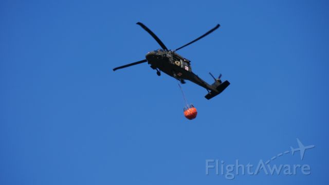 — — - Minnesota National Guard with water drop to put out fires