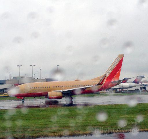 Boeing 737-700 (N714CB) - A different version of Southwest Airlines lands at the Hartsfield-Jackson Atlanta International Airport, Atlanta, GA