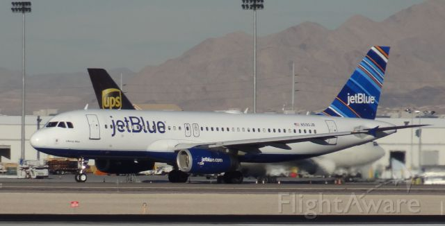 Airbus A320 (N590JB) - Taken on December 31, 2013. This Airbus A320 was taking off from runway 1 at Las Vegas McCarran Airport heading to Daugherty Field in Long Beach, California.