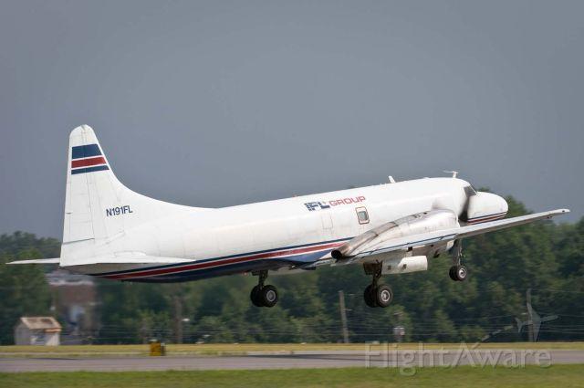 CONVAIR CV-580 (TSU191) - Departing Hickory off Rwy 24.