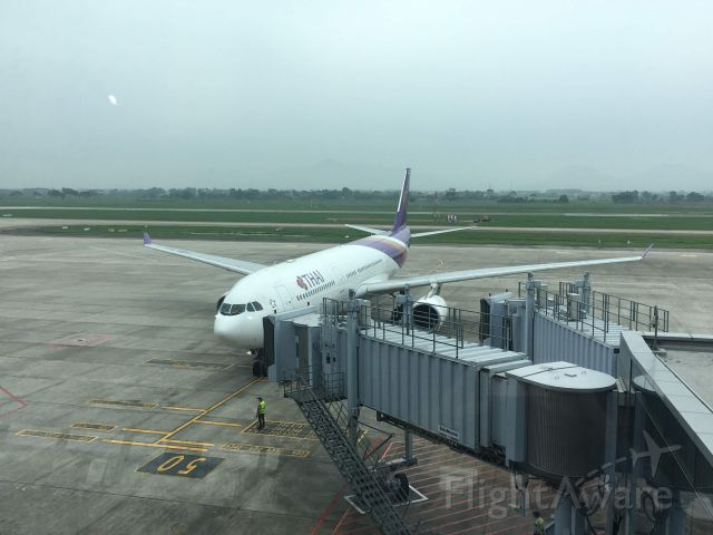 Airbus A330-200 — - A normal Thai Airways Airbus A330 parked at it's gate at Noi Bai International Airport (just that it had VIP passengers onboard).
